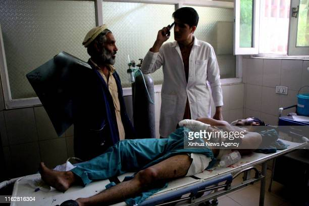 Aug. 19, 2019 -- An injured man receives medical treatment at a local hospital in Nangarhar province, Afghanistan, Aug. 19, 2019. At least 17 people...