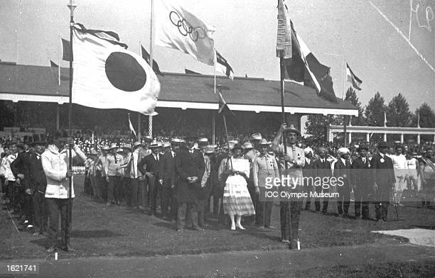 The Japanese and Italian Delegations standing during the Opening Ceremony of the 1920 Olympic Games at the Olympic Stadium in Antwerp, Belgium. \...