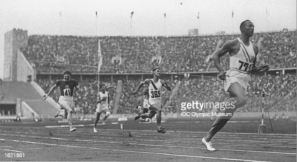 Jesse Owens of the USA leads Kichizo Sasaki of Japan during the preliminary heat of the 100 metres event at the 1936 Olympic Games in Berlin Owens...