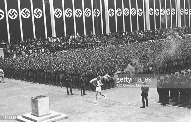 The Olympic Flame arrives at the Lustgarten during the Youth Festival before the 1936 Olympic Games in Berlin Mandatory Credit IOC Olympic Museum...