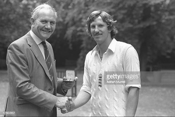 Alec Bedser presents Ian Botham of England with a special Cornhill Medal for taking the fastest ever 100 test wickets after the England v India test...
