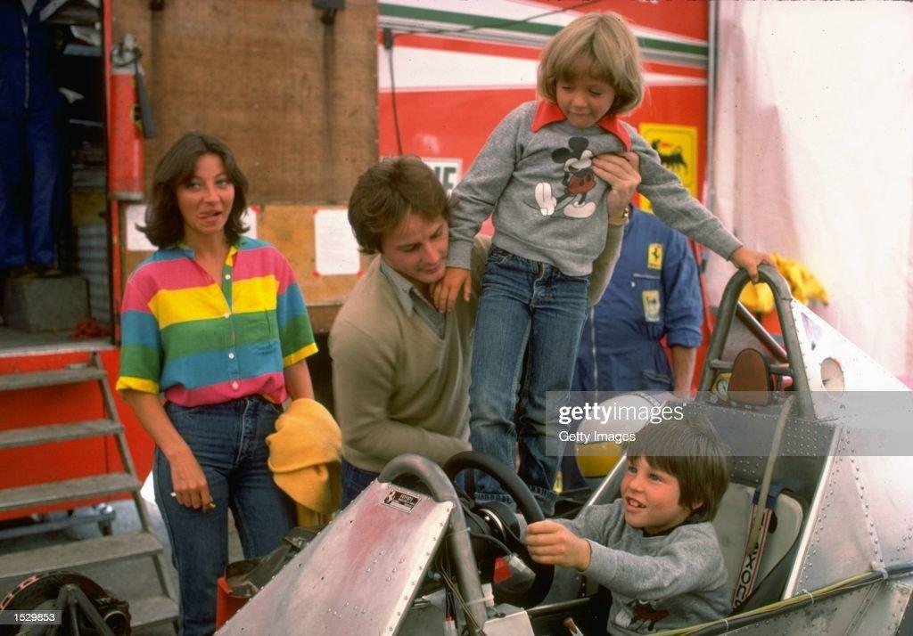 Gilles Villeneuve puts son Jacques at the Controls of his  Ferrari Formula One racing car : News Photo