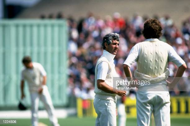 England Captain Mike Brearley talks to Vice Captain Bob Willis during the Fifth Ashes Test match against Australia at Old Trafford in Manchester...
