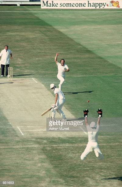 Ian Botham of England takes the wicket of Terry Alderman of Australia to tie up victory in the 4th Ashes Test match between England and Australia at...