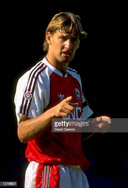 Tony Adams of Arsenal directs instructions to his team mates during the Football League Division One match against Manchester City played at Highbury...