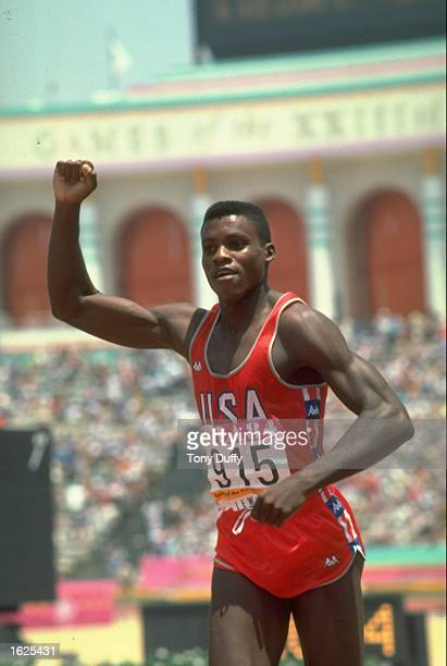 Carl Lewis of the USA salutes the crowd after winning the 100 Metres event at the 1984 Olympic Games in Los Angeles USA Lewis won the gold medal in...