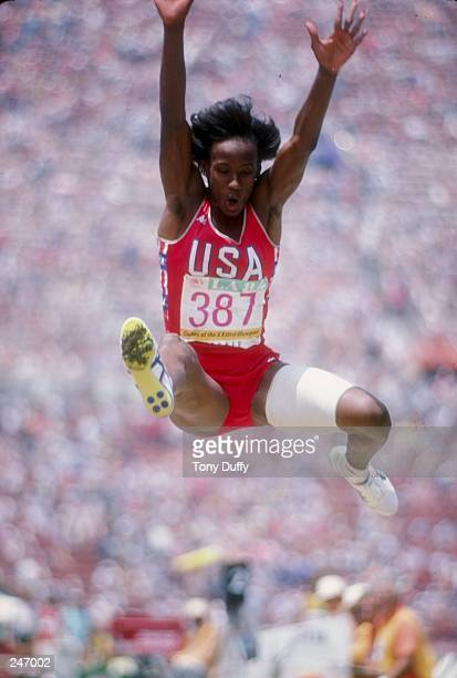 Jackie JoynerKersee flies through the air on the long jump as part of the heptathlon competition at the Olympic Games in Los Angeles California