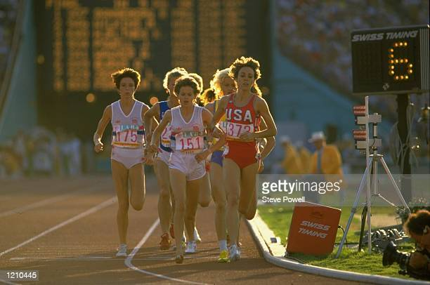 Zola Budd of Great Britain and Mary Decker of the USA lead the field during the 3000m final at the Summer Olympic Games at the Colliseum Stadium in...
