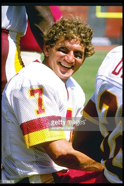 Quarterback Joe Theismann of the Washington Redskins looks on during a pre-season game against the Los Angeles Raiders at the Los Angeles Memorial...