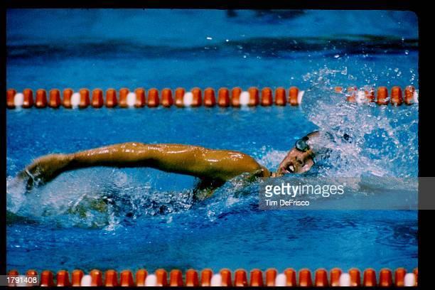 Janet Evans swims during a race. Mandatory Credit: Tim de Frisco /Allsport