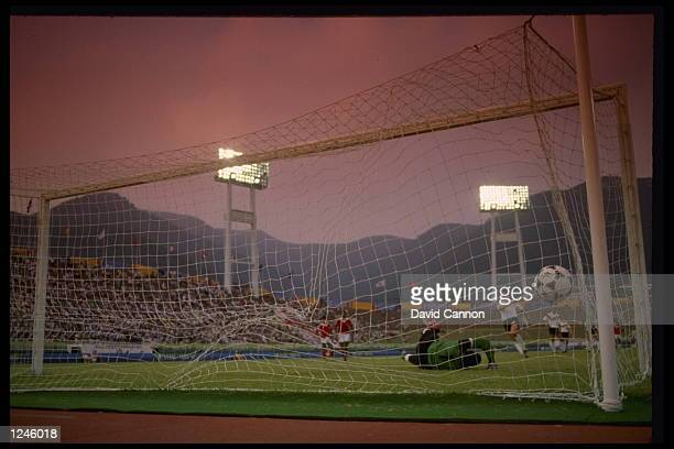 W Wuttke of West Germany scores on a penalty kick during a 41 win over Tunisia during the 1988 Olympic Games in Seoul Korea Mandatory Credit David...
