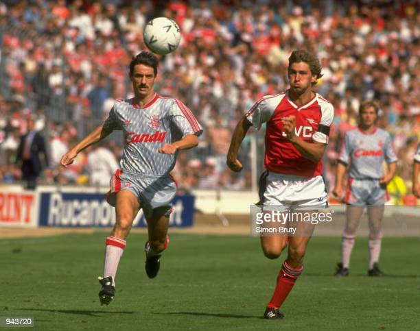 Ian Rush of Liverpool and Tony Adams of Arsenal in action during the Charity Shield match at Wembley Stadium in London Liverpool won the match 10...