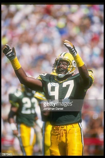 Defensive lineman Tim Harris of the Green Bay Packers celebrates during a preseason game against the New Orleans Saints at Camp Randall Stadium in...
