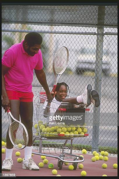 Richard Williams pushes his daughter Venus around in a shopping cart during practice Mandatory Credit Ken Levine /Allsport