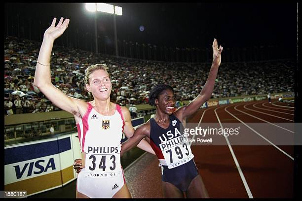 Katrin Krabbe of Germany celebrates her victory over Gwen Torrence of the USA in the 200m final during the world championships in the national...