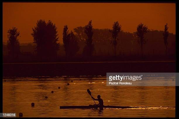 An impression of a canoer at sunset during the canoeing event at the 1992 Olympic Games in Barcelona Spain Mandatory Credit Pascal Rondeau/Allsport