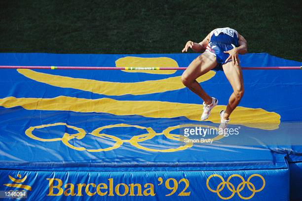 Dave Johnson of the USA clears the high jump bar during the decathlon competition at the 1992 Summer Olympics in Barcelona, Spain. Mandatory Credit:...