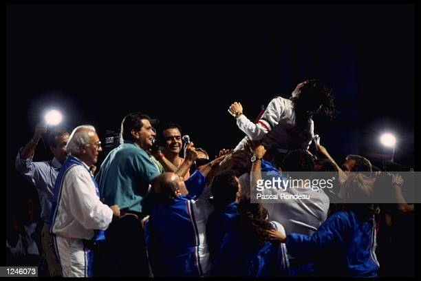 Giovanna Trillini of Italy in action against Wang Huifeng of China in the Mens Fencing Final at the 1992 Olympic Games held in Barcelona Spain...