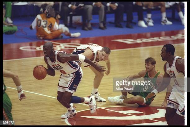 Guard Michael Jordan of the United States moves the ball during a game at the Barcelona Olympics in Barcelona, Spain. Mandatory Credit: Mike Powell...