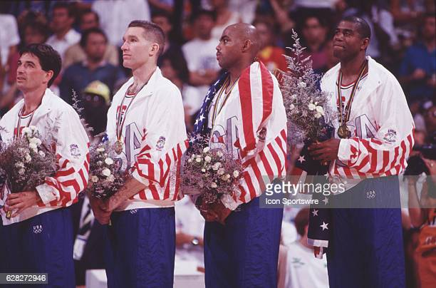 John Stockton Chris Mullen Charles Barkley and Magic Johnson of the USA during the medal cermony after winning gold medal in men's basketball at the...