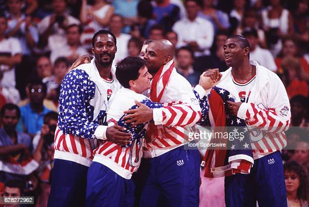 LR Karl Malone John Stockton Charles Barkley and Magic Johnson of the USA celebrate winning the gold medal during the medal ceremony in men's...