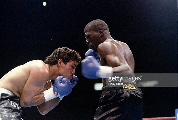 Roger Mayweather and Pedro de la Cruz trade blows during a bout Mandatory Credit Holly Stein /Allsport