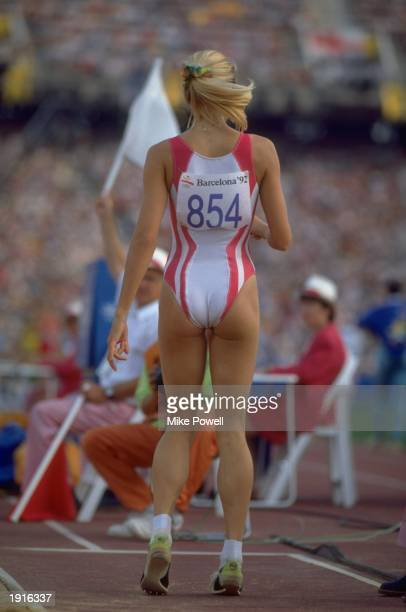Susen Tiedtke of Germany stands up from the sand pit after a successful jump in the Long Jump event on Day 13 of the 1992 Olympic Games in Barcelona...