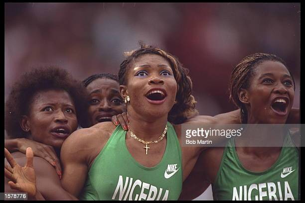 The womens 4x100m relay team of Nigeria start to celebrate as the watch a video replay of their race on the giant stadium screens and discover they...