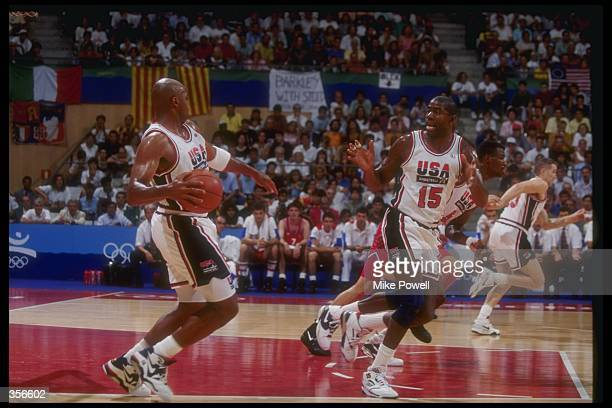 United States forward Charles Barkley and guard Earvin 'Magic' Johnson move down the court during a game at the Olympic Games in Barcelona Spain...