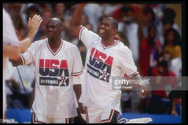 6777c5901728 United States guard Michael Jordan and guard Earvin  Magic  Johnson  celebrate during a game