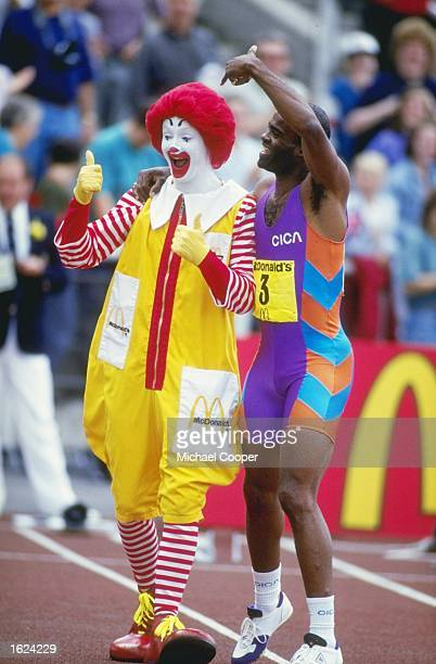 Metre Hurdler Kriss Akabusi of Great Britain clowns around with Ronald McDonald at the McDonalds Games in the Don Valley Stadium, Sheffield, England....