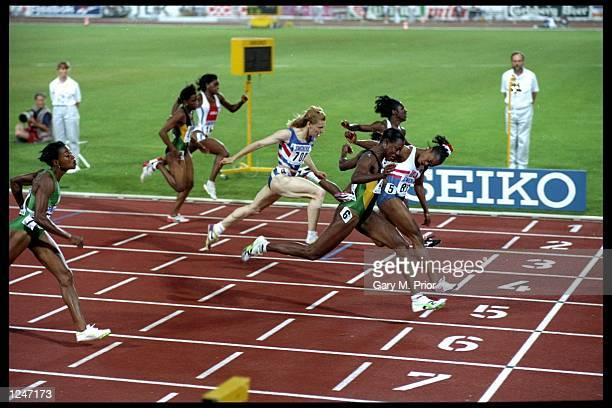 Gail Devers of the USA and Merlene Ottey of Jamaica dip for the line in the 100 metres final at the World Championships held in the Gottlieb Daimler...