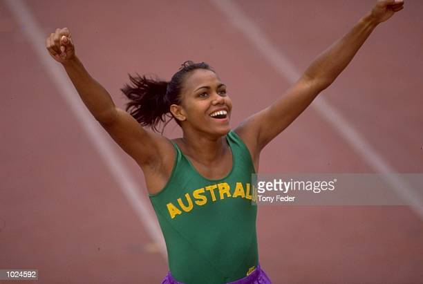 Cathy Freeman of Australia celebrates after winning the 400 metres final during the Commonwealth Games in Victoria, Canada. Freeman won the gold...