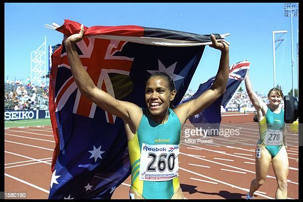 Cathy Freeman of Australia snd team mate Melinda Gainsford celebrate their silver medal in the 4x100m relay at the Commonwealth games in Victoria,...