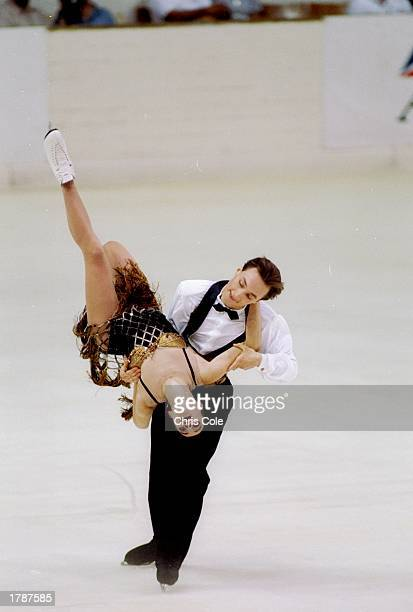 Irina Romanova and Igor Yaroshenko of Russia perform their routine during the Ice Dance competition at the Goodwill Games in St Petersburg Russia...