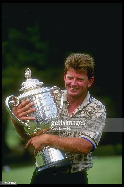 Nick Price of South Africa hugs his championship trophy from the PGA Championship at Southern Hills Country Club in Tulsa Oklahoma Mandatory Credit...