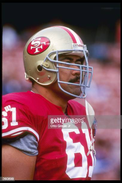 Offensive lineman Jesse Sapolu of the San Francisco 49ers looks on during a preseason game against the Seattle Seahawks at Candlestick Park in San...