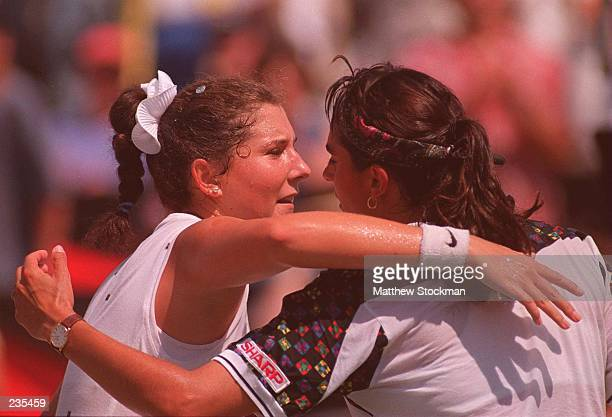 A VICTORIOUS MONICA SELES IS CONGRATULATED BY GABRIELA SABATINI AFTER their MATCH