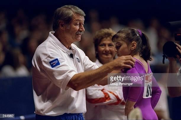 Coach Bela Karolyi speaks with Dominique Moceanu during the USA Gymnastic Nationals Mandatory Credit Doug Pensinger /Allsport