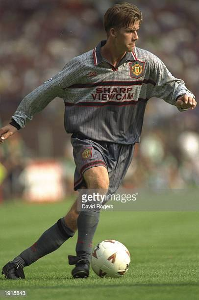 David Beckham of Manchester United in action against Aston Villa in the FA Carling Premiership at Villa Park Birmingham Aston Villa won 31 Mandatory...