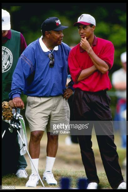 Earl and Tiger Woods talk to one another at the US Amateur Championship at the Newport Country Club in Newport Rhode Island Mandatory Credit JD Cuban...