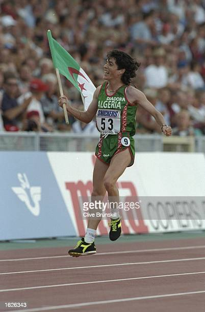 Hassiba Boulmerka of Algeria celebrates with her national flag after winning the 1500 metres event at the World Championships at the Ullevi Stadium...