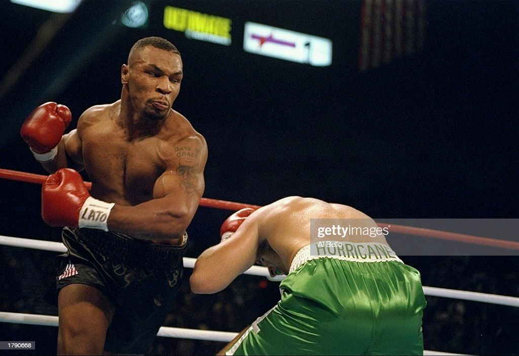 Mike Tyson sends Peter McNeeley to the canvas during the first round of Tyson''s comeback bout at the MGM Grand Garden in Las Vegas, Nevada. Tyson was declared the winner after McNeeley''s manager stopped the fight. Mandatory Credit: Al Bello /Allsport