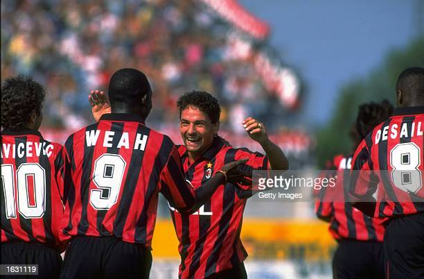 Roberto Baggio of AC Milan and team mate George Weah celebrate during a Serie A match against Padova Calcio at the Silvio Appiani Stadium in Padua...