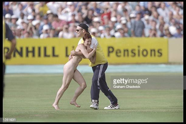 A streaker interupts play during the second test match between England and Pakistan at Headingley in Leeds Mandatory Credit Graham Chadwick/Allsport...