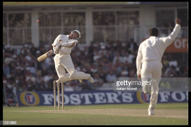 Alec Stewart of England avoids a bouncer from Wasim Akram of Pakistan during the third test between England and Pakistan at the Oval in London...