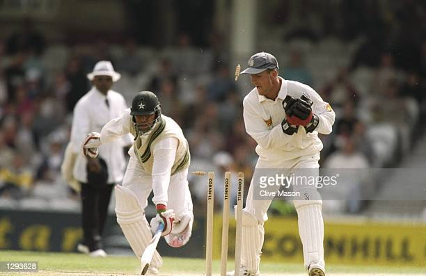 Alec Stewart of England is run out by Moin Khan of Pakistan during the Third Test match at the Kennington Oval in London Mandatory Credit Clive...