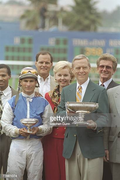 Alex Solis left jockey for Dare and Go stands with Pete Wilson California governer after winning the Pacific Classic at Del Mar Race Track in Del Mar...