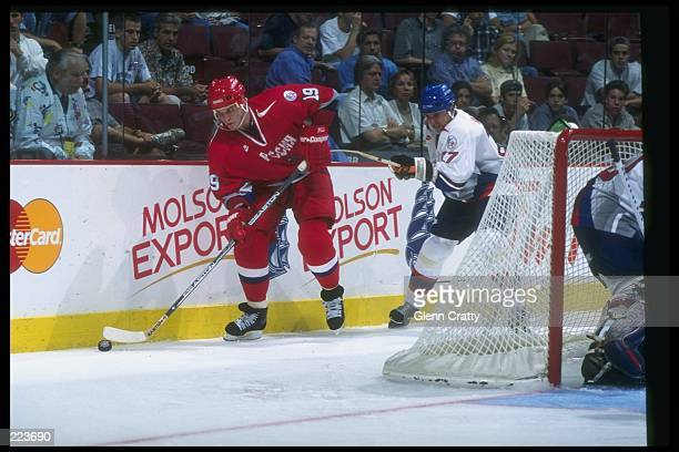Alexei Yashin of Russia and Jan Varholik of Slovakia go for the puck during a World Cup game at the Molson Center in Montreal Quebec Russia won the...