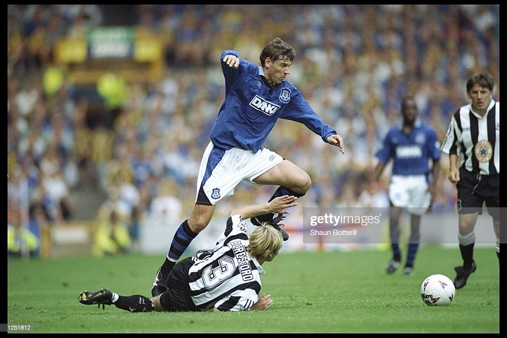 Andrei Kanchelskis of Everton skips over a challenge from John Beresford of Newcastle : News Photo